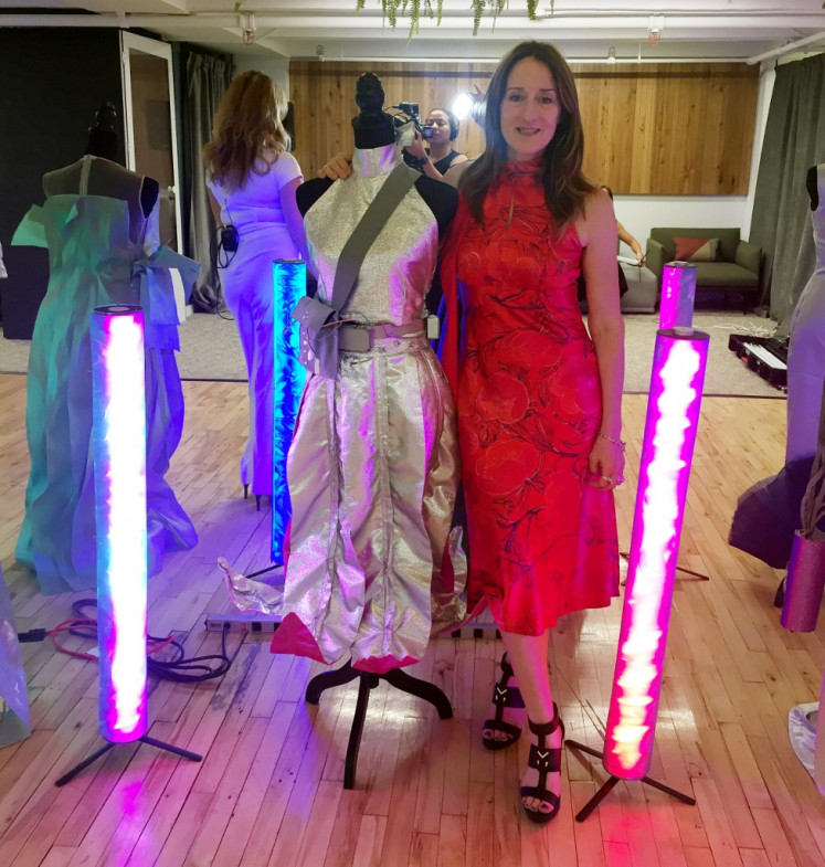 Clare Tattersall poses with some of her creations her at the Robotic Dress Exhibition on September 9, 2019 in New York.