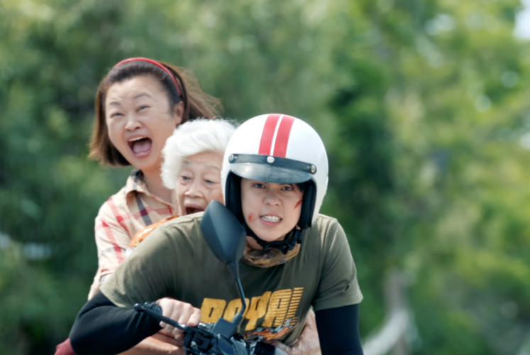 Sakkarin gives a ride to his mother (Jennifer Kim, left above) and his grandmother (left, middle) in Thai comedy-drama film 'Bikeman'.