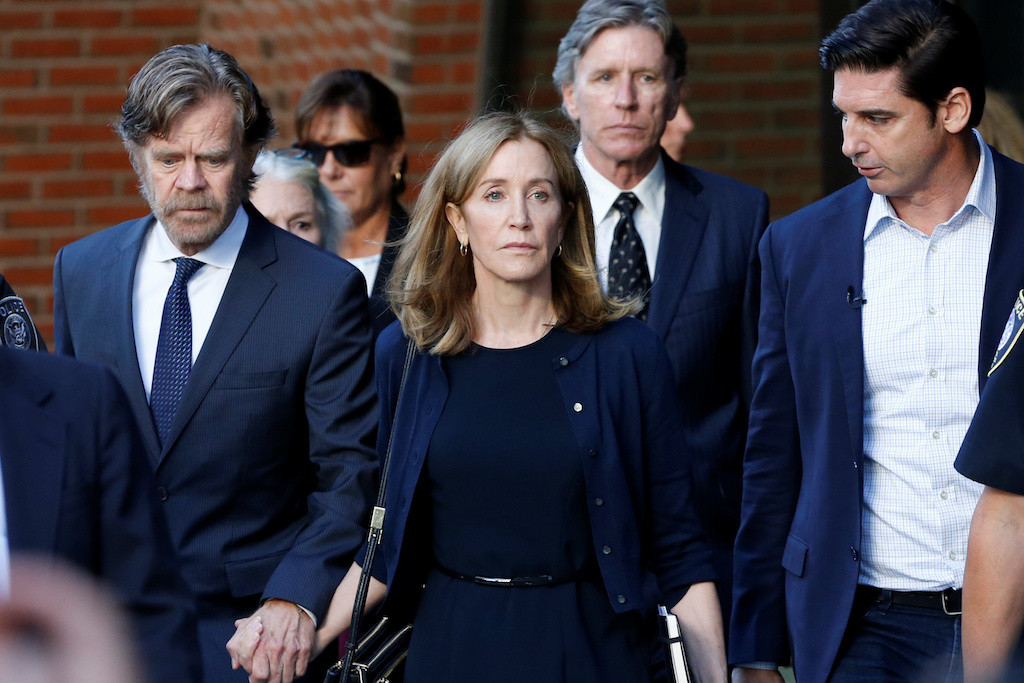 Apologetic actress Felicity Huffman gets 14-day sentence in US college scandal