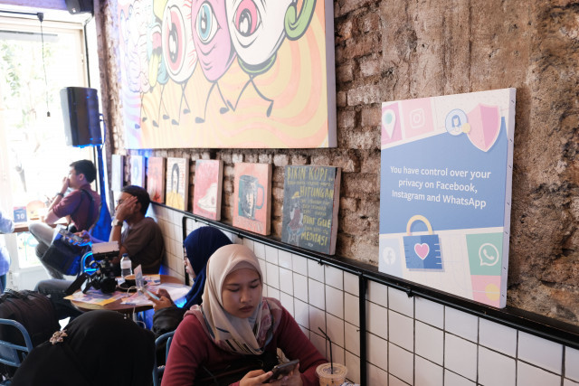Updating knowledge: At the café, visitors can have a chat with a Facebook officer on ways to make their Facebook, Whatsapp or Instagram accounts more secure.