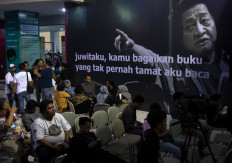 Quotations from the late theater maestro and poet WS Rendra at the festival's entrance gate. JP/Tarko Sudiarno