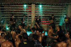 Participants in the 2019 Jatiwangi Cup bodybuilding championship dance en masse as the band Lair performs at the Dua Saudara jebor in Burujul Kulon, Majalengka, West Java, recently. The annual championship has become an entertaining event for locals of different ages. JP/Arya Dipa