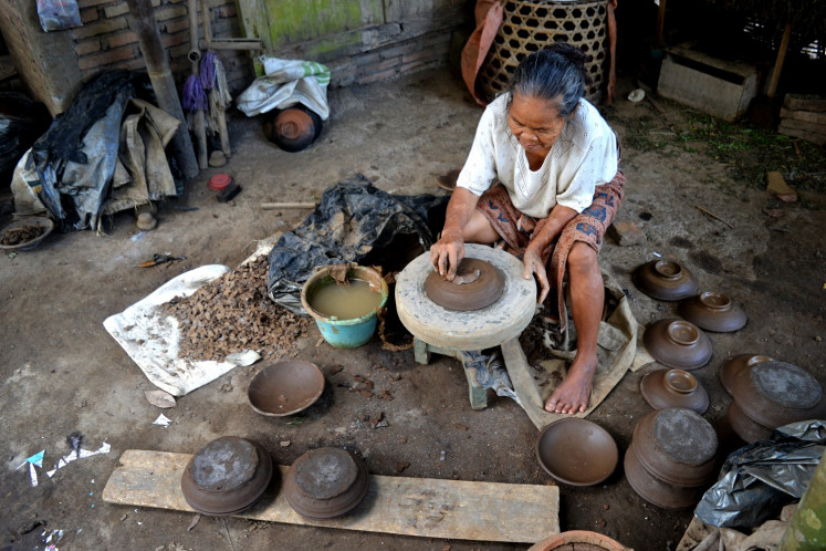 A resident of Klipoh village in Magelang makes earthenware products.