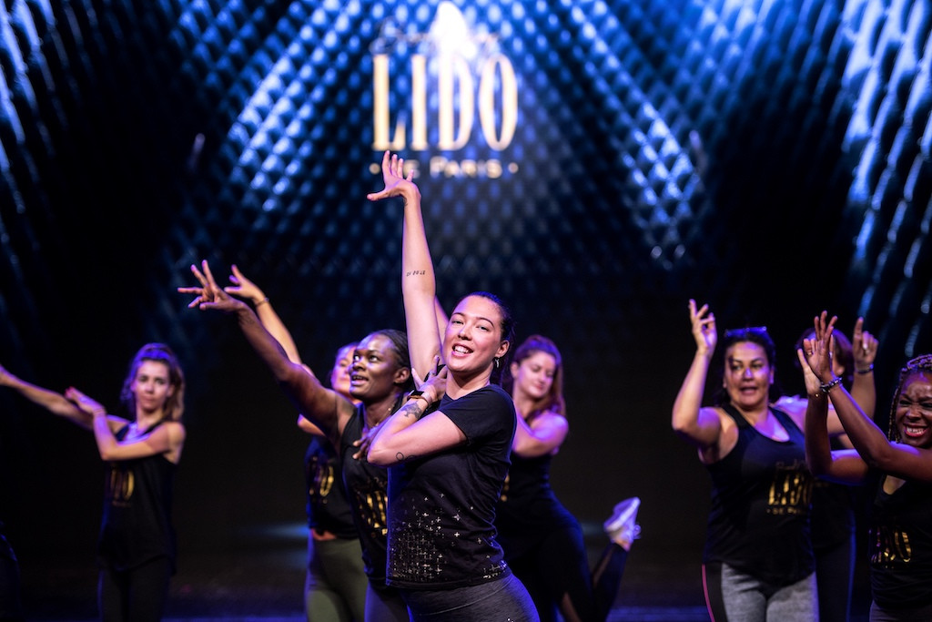 Paris showgirls ride out feminist wave with fitness tips