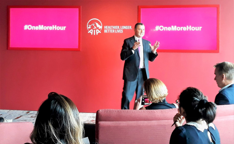 Fighting sleep loss: AIA Group chief marketing officer Stuart A. Spencer presents his company's newly launched initiative, #OneMoreHour, designed to help combat sleep deprivation, in Singapore on Sept. 16.
