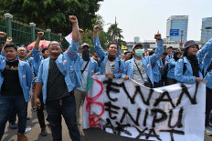 Indonesian students hold a protest against the government's proposed change in its criminal code laws and plans to weaken the anti-corruption commission, outside the parliament building in Jakarta on September 24, 2019. - Indonesia's President Joko Widodo on September 20 called for a delay in passing a new criminal law overhaul that would outlaw gay and pre-marital sex after the controversial plan sparked a public outcry. Updating Indonesia's criminal code -- which stretches back to the Dutch colonial era -- has been debated for decades and appeared set to pass in 2018 before it fizzled. AFP/Adek Berry