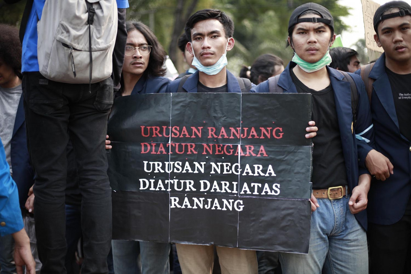 Students protest against the planned revision Criminal Code and the revision to Corruption Eradication Commission law in front of the House of Representatives building in Senayan, Jakarta on Sept. 24. JP/Narabeto Korohama