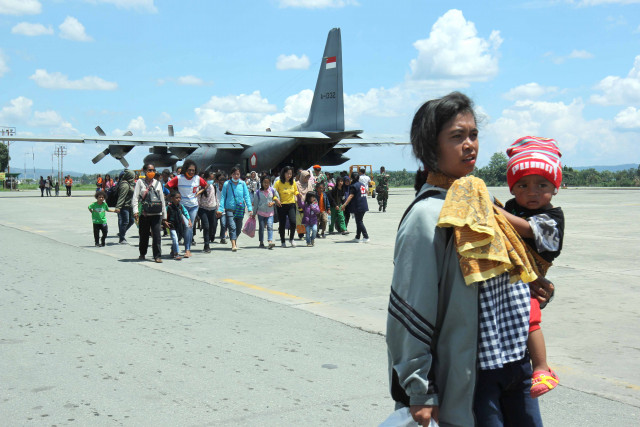 Evacuees wait their turn to board an Indonesian Military aircraft at Wamena Airport in Jayawijaya regency on Sept. 28 following a deadly riot on Sept. 23.
