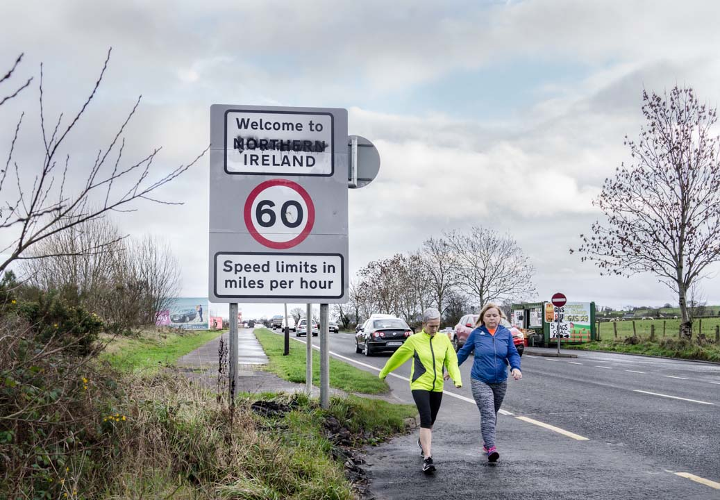 Two women walk past the border between Northern Ireland and the Republic of Ireland on Buncrana Road in the western suburbs of Derry/Londonderry. JP/Okky Ardya