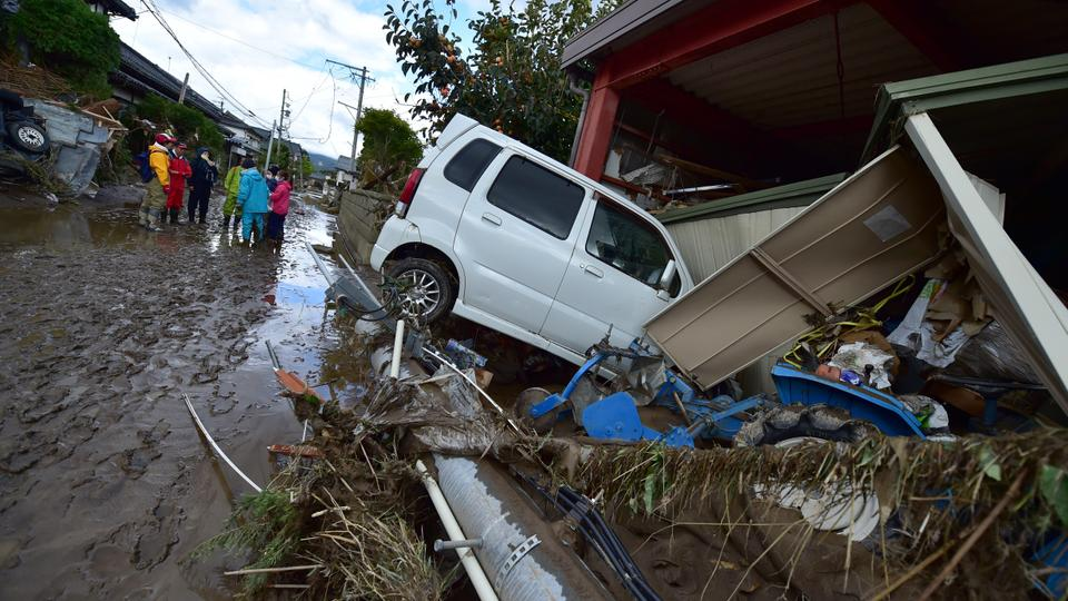 67 dead, rescuers in 'day and night' hunt for missing after Japan typhoon