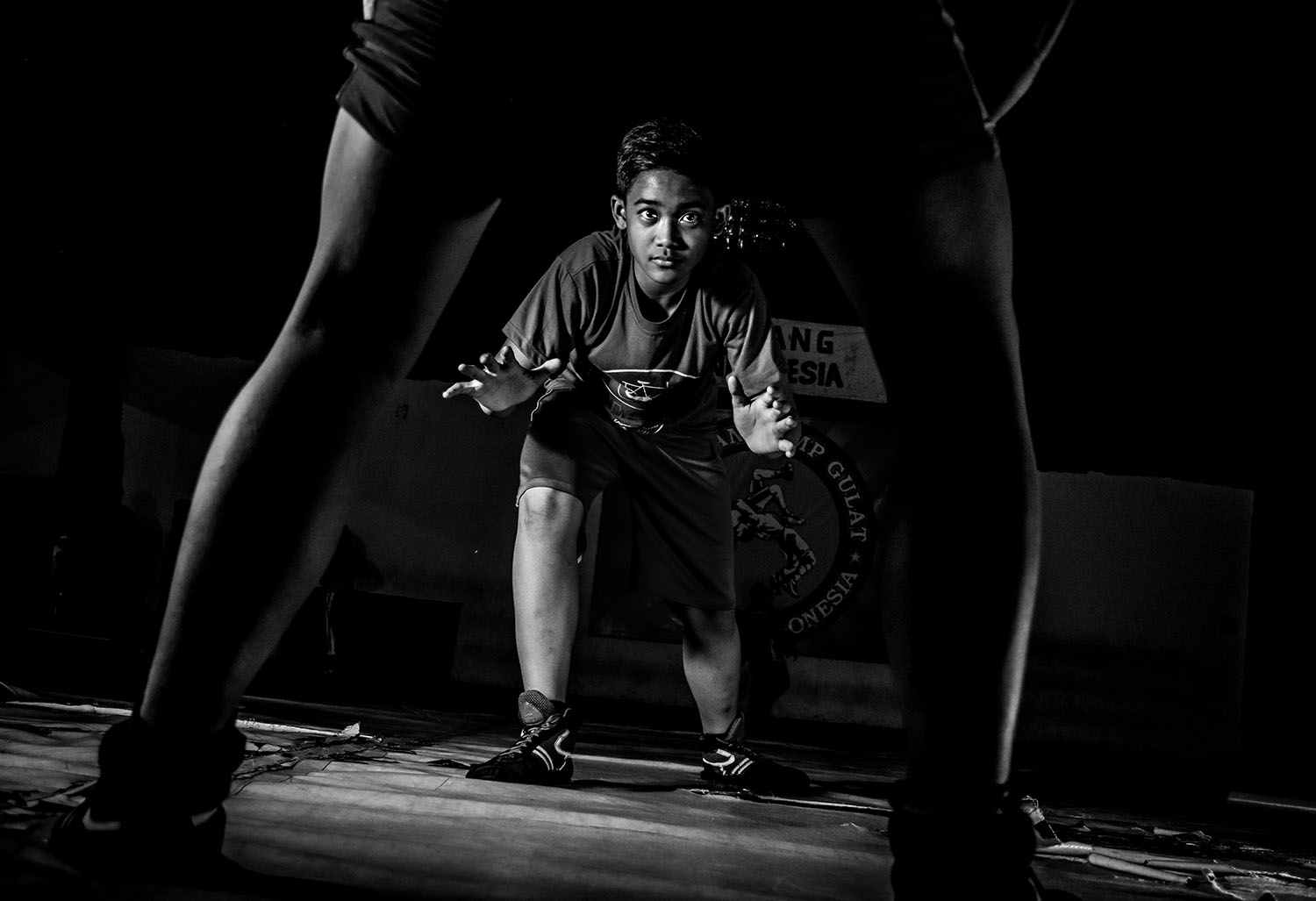 Dias Aditya, 15, learns an attack movement. He has been attending the Rachman Wrestling Camp for a year. JP/Aman Rochman