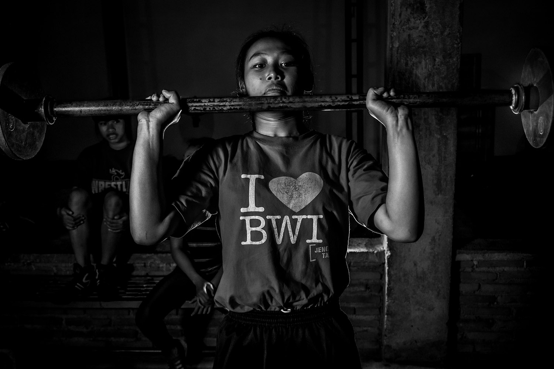 Reni Farida, 15, a young wrestler from Banyuwangi, lifts weights at the camp. JP/Aman Rochman