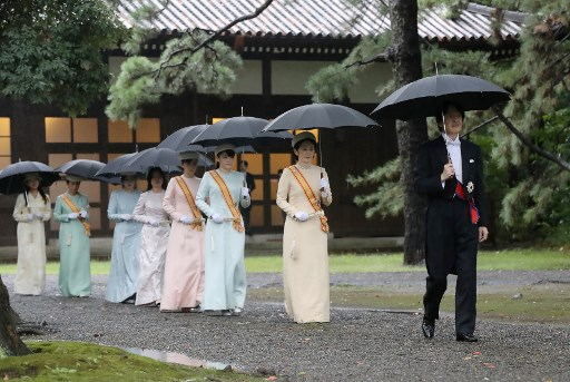 Japan plans to postpone imperial parade over typhoon