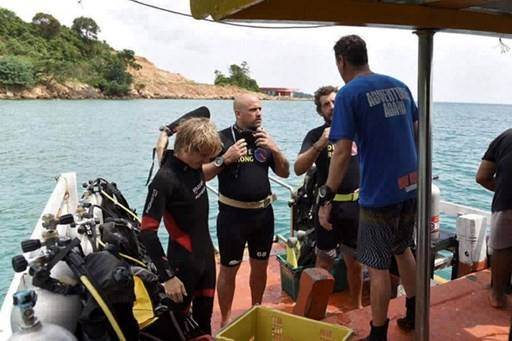 Cambodian soldiers, divers scour island for missing Brit tourist
