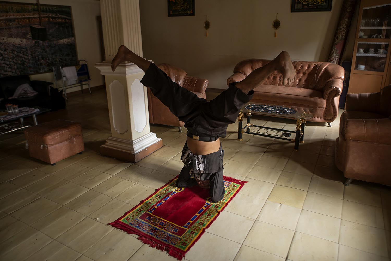 Practicing silat on sajadah (prayer mat) is considered an exercise to improve one's strength and balance. JP/Ramadhani