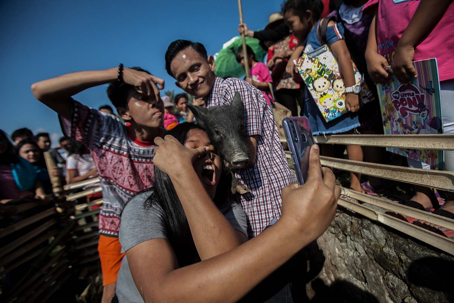 Smile together: Contestants take selfies with pigs during the Lake Toba Pig and Pork Festival 2019. JP/Andri Ginting