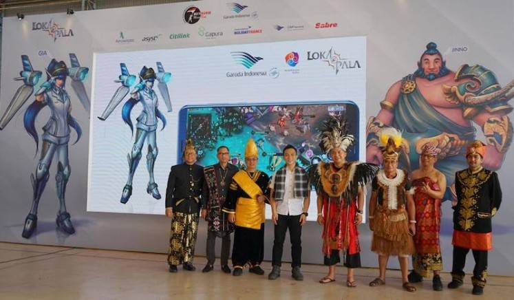 Garuda Indonesia director Ari Askhara (fourth right) and high-ranking officers of Anantarupa Studios introduce online video game character GIA from