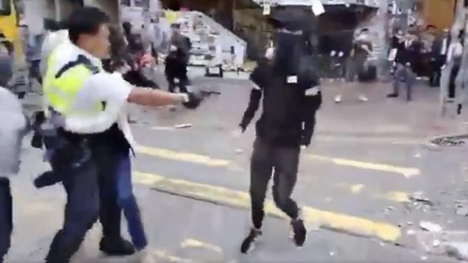 Hong Kong police shoot protester as protests start working week