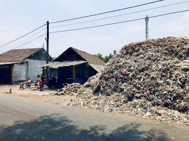 Where's home?: Bangun village in East Java has been inundated by plastic waste imported from Western countries and elsewhere.countries and elsewhere.
