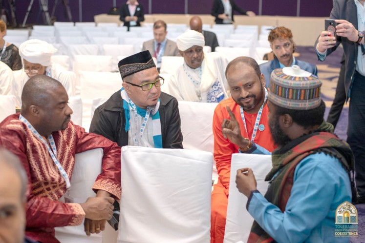 Exchanging ideas: Swami Chidakashananda from Sri Lanka (second right) talks to participants representing other faiths during the international conference on tolerance on Saturday.