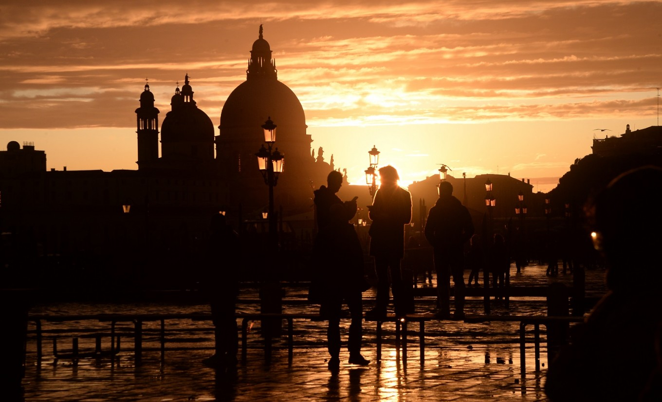 St Mark's closed as water again invades Venice, rain lashes Italy