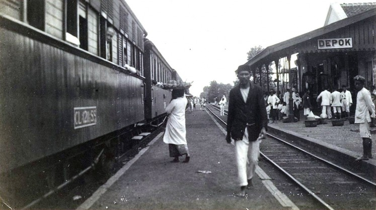 Black and white: People are seen at Depok station during the colonial years.