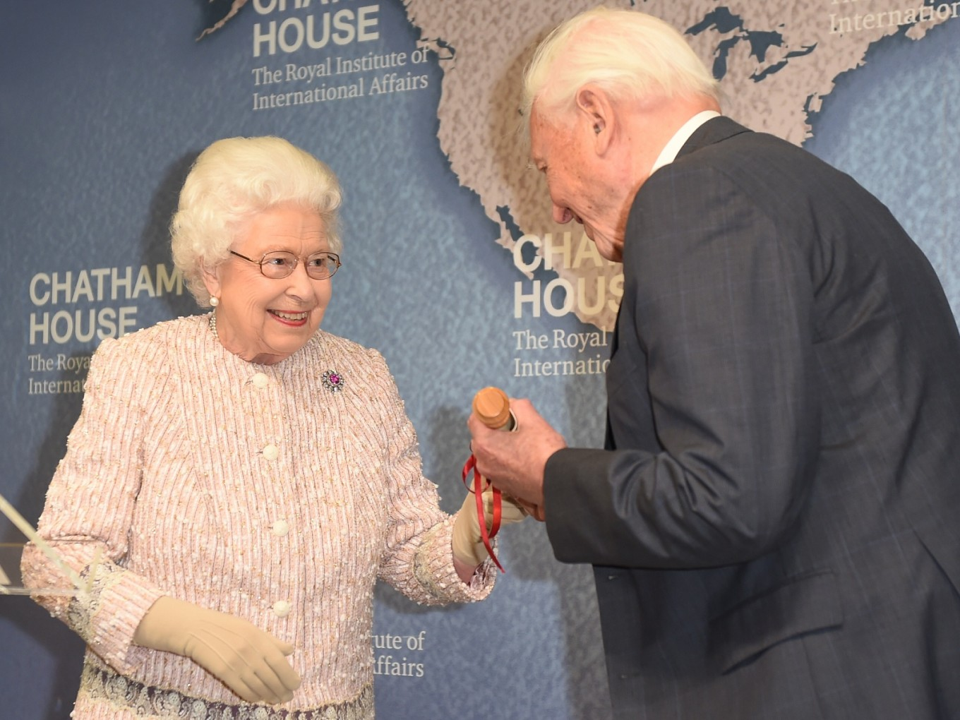 Queen presents Attenborough with prize for Blue Planet series