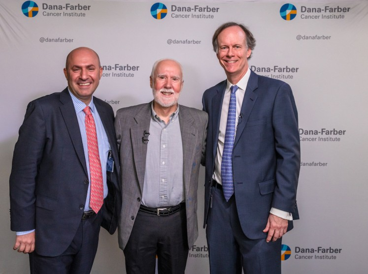 This handout picture taken by Sam Ogden on Nov. 11, 2019 shows Dr William G. Kaelin (right) and Dr. Toni K. Choueiri (left) posing with patient Shaun Tierney at the Dana-Farber Cancer Institute in Boston, Massachusetts.