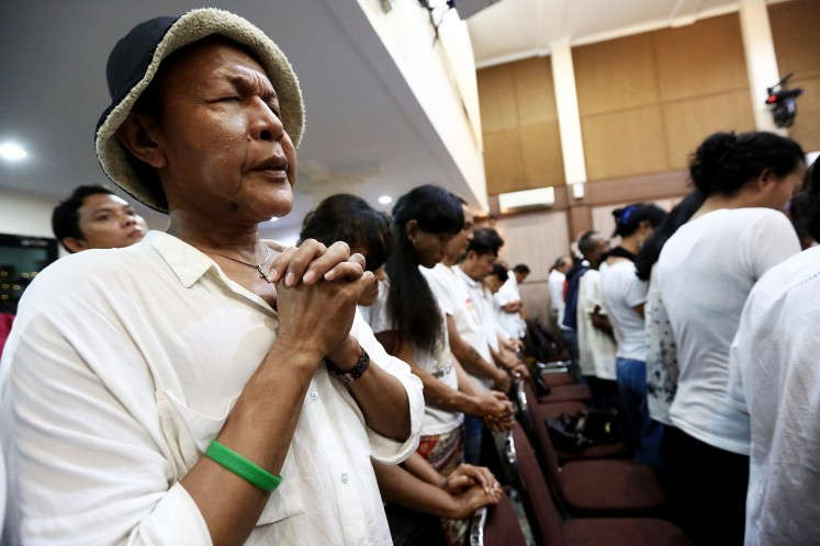 Keep the faith: Christian transgenders pray during a Christmas celebration at the Bethel Church of Indonesia (GBI) in Ampera, Jakarta, in December last year.