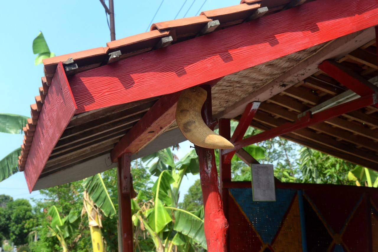 A 'kentongan' is attached to a security guard post at Jambu Kulon village in Klaten regency, Central Java.