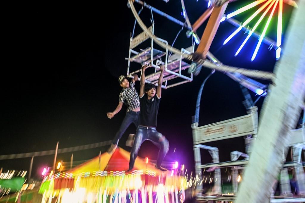 Riding high on Myanmar's human-powered Ferris wheels