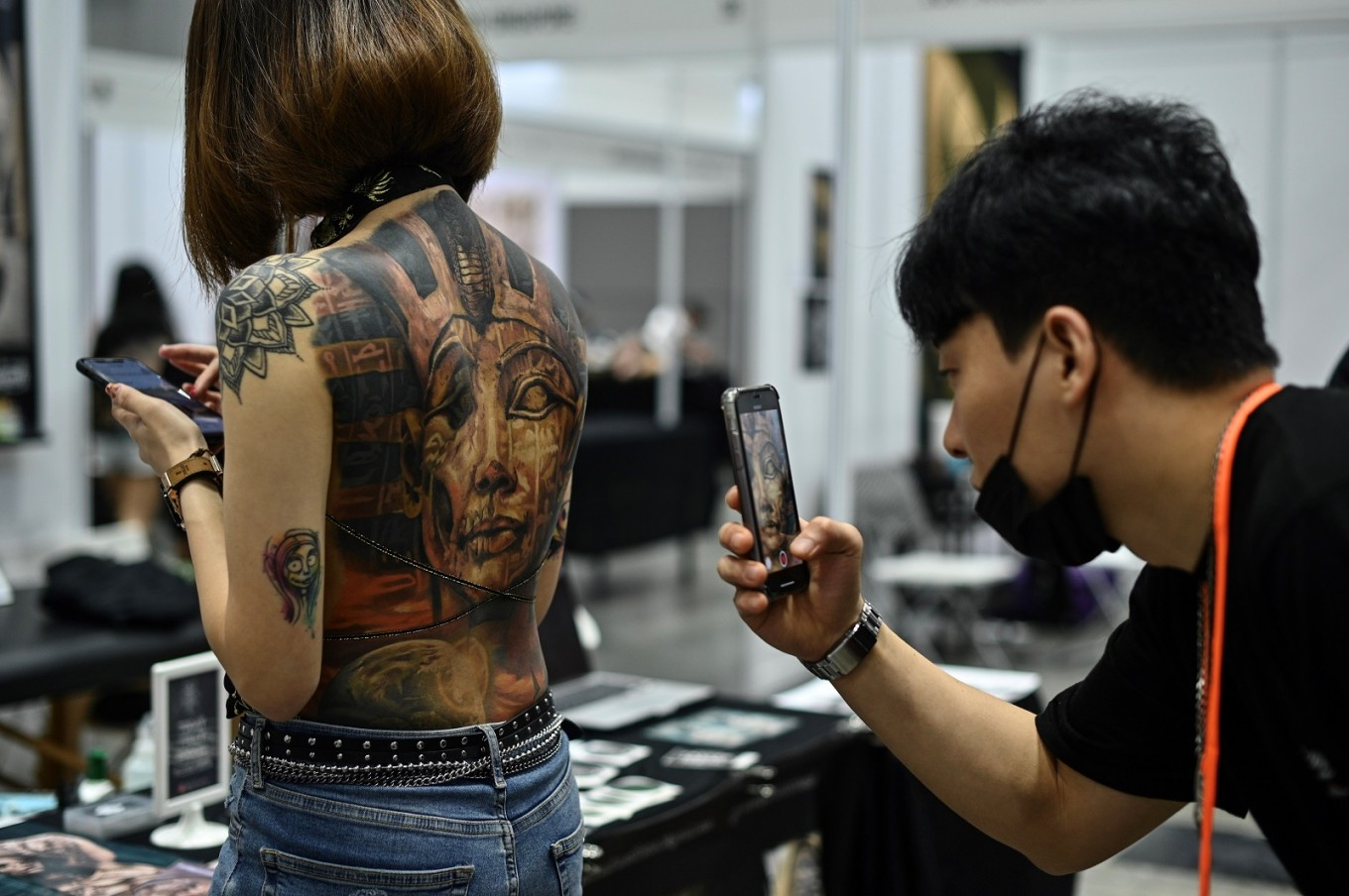 Malaysia orders inquiry over 'half-naked' tattoo show