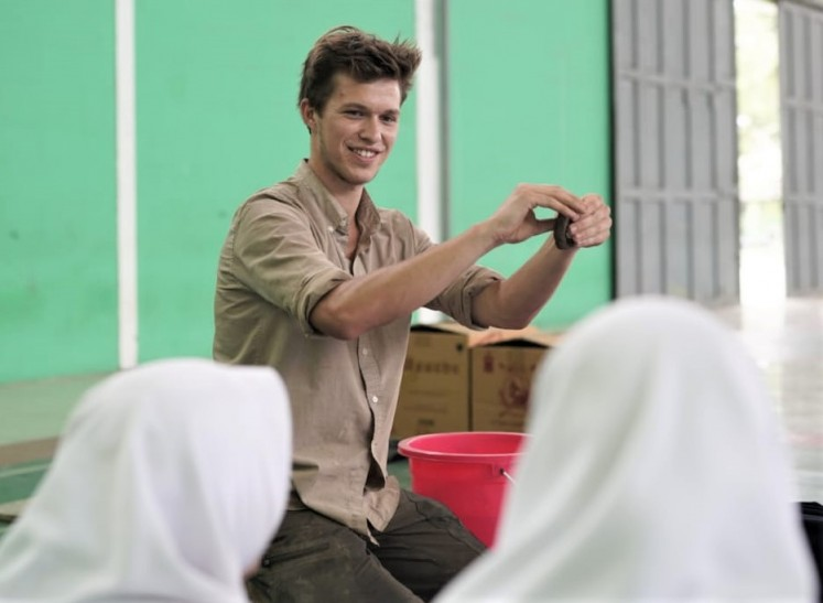 Here we go:  Danish artist Emil Krog Rasmussen demonstrates clay modelling technique in his collaborative public sculpture project 'Connecting Clay' to the students at Al-Mizan Islamic Boarding School in Jatiwangi, West Java.
