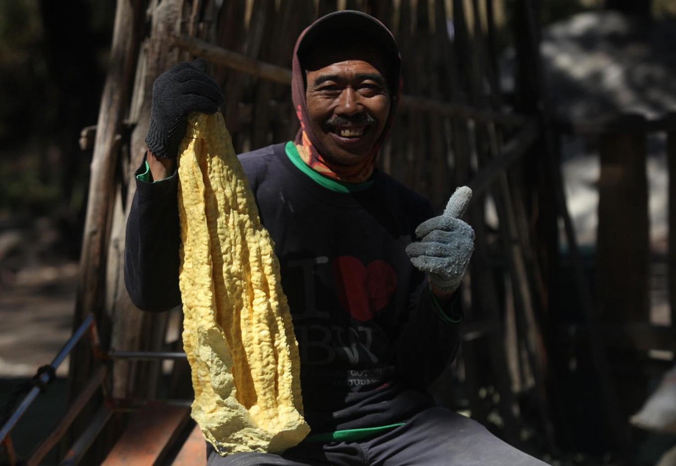 Matri, a miner, displays the sulfur he mined from Ijen Crater. JP/Boy T Harjanto