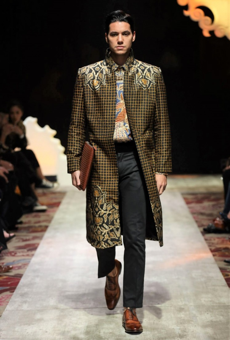 Formal: The men's silhouettes are classically masculine, with boxy shapes and a strong shoulder line.