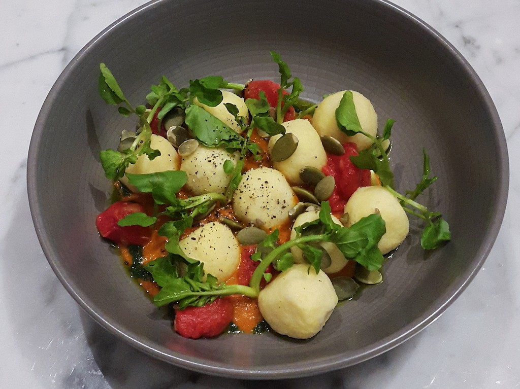 Cuca Bali's ricotta gnocchi is cheese dumplings with roasted watermelon and sun-dried tomato pesto.