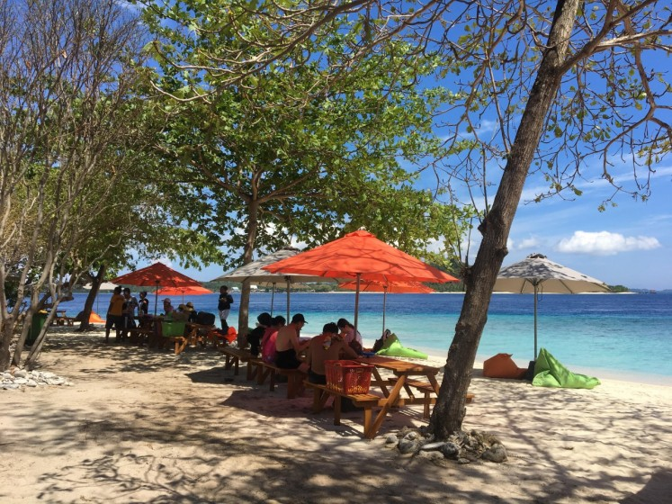 Faraway island: Tourists enjoy a sunny day on Lihaga Island in West Likupang, North Minahasa, North Sulawesi. It takes 60 minutes to drive from Manado, the North Sulawesi provincial capital, to Likupang, where tourists must then spend 15 minutes crossing the sea to reach the island.