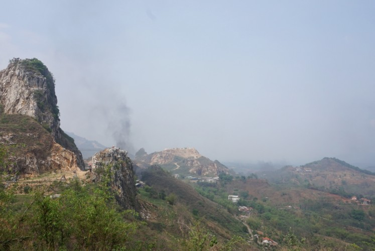 Black smoke rises during our visit to the geopark.