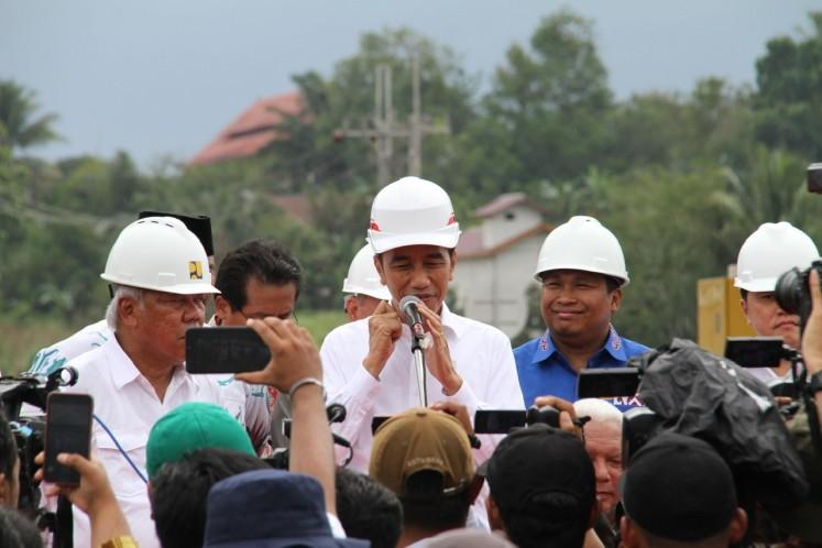 "President Joko ""Jokowi"" Widodo speaks to journalists after the inauguration of three sections of Balikpapan-Samarinda toll road in in Samboja, Kutai Kertanegara Regency in East Kalimantan on Tuesday."