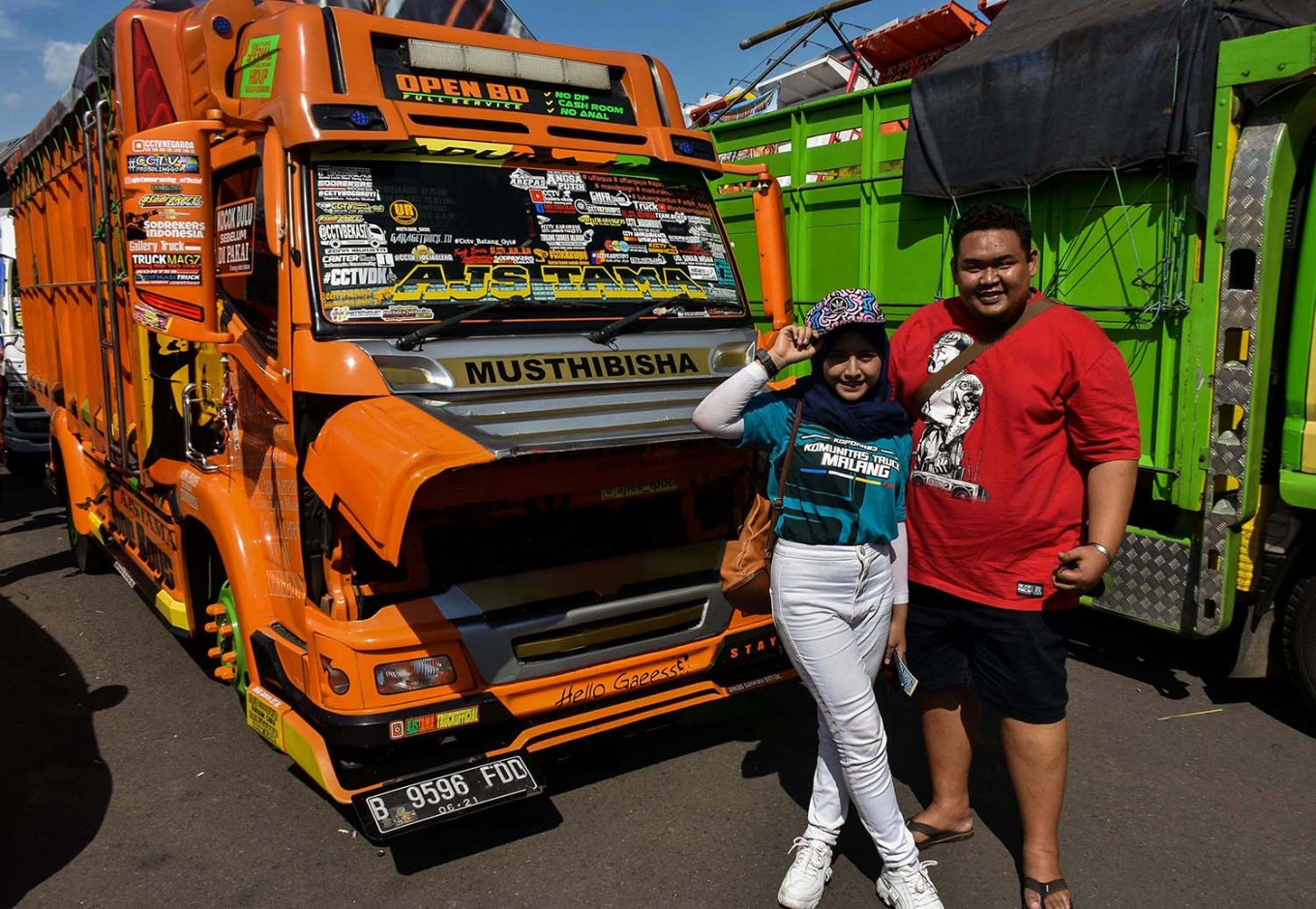 Making friends: Erlianda Alfajri (left) from the CCTV truck lovers' community in Blitar, East Java, poses with truck owner Ajie Ipoel from Bekasi, West Java. JP/Aman Rochman