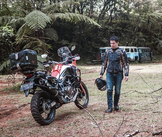 Indonesian couple taking country on motorbike tour around the world