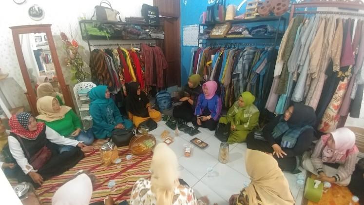 Members of Wanita Mandiri Ibun (WMI) gather at It's Blazer Ibun gallery in Lampegan village, Ibun district, Bandung, on  Dec. 7.