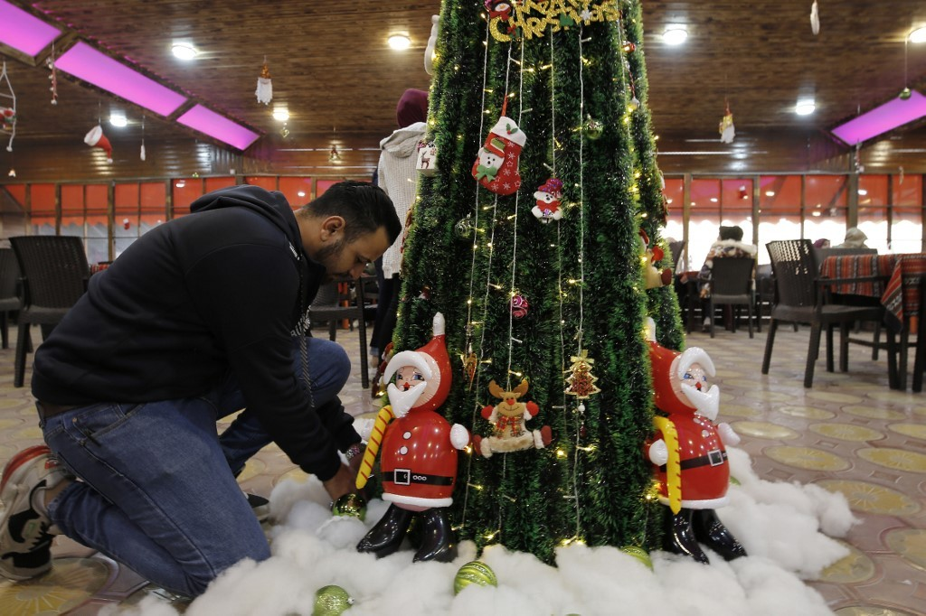 In Gaza, a somber Christmas after permits row