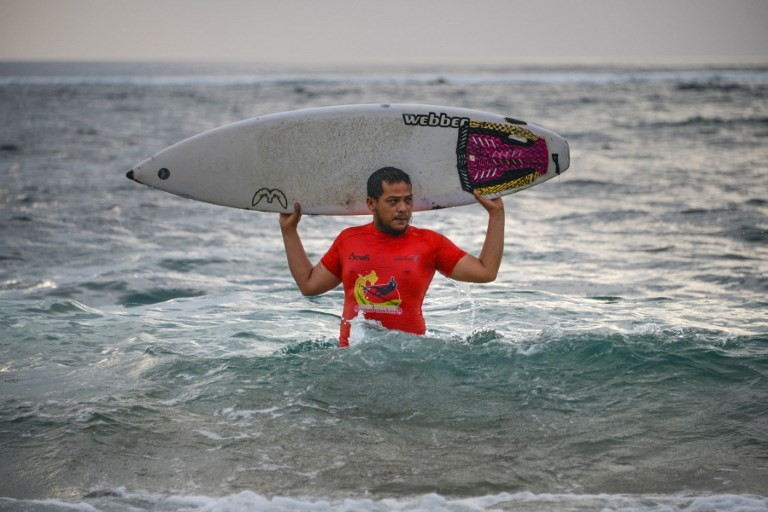 Survival surfing: Indonesians riding the waves to beat tsunami trauma
