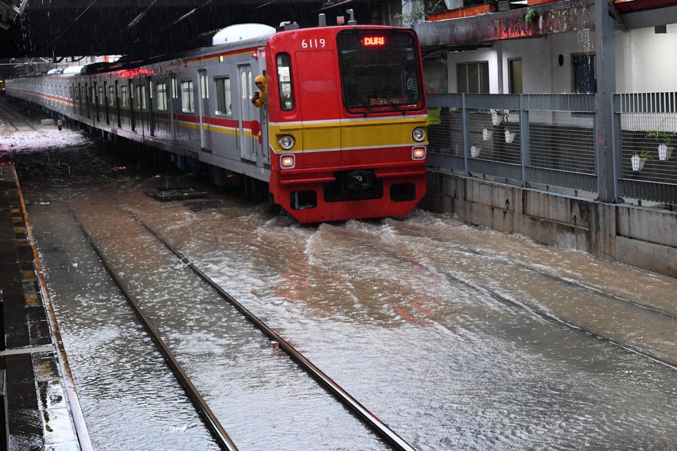 Flights disrupted, trains delayed as massive floods hit Jakarta