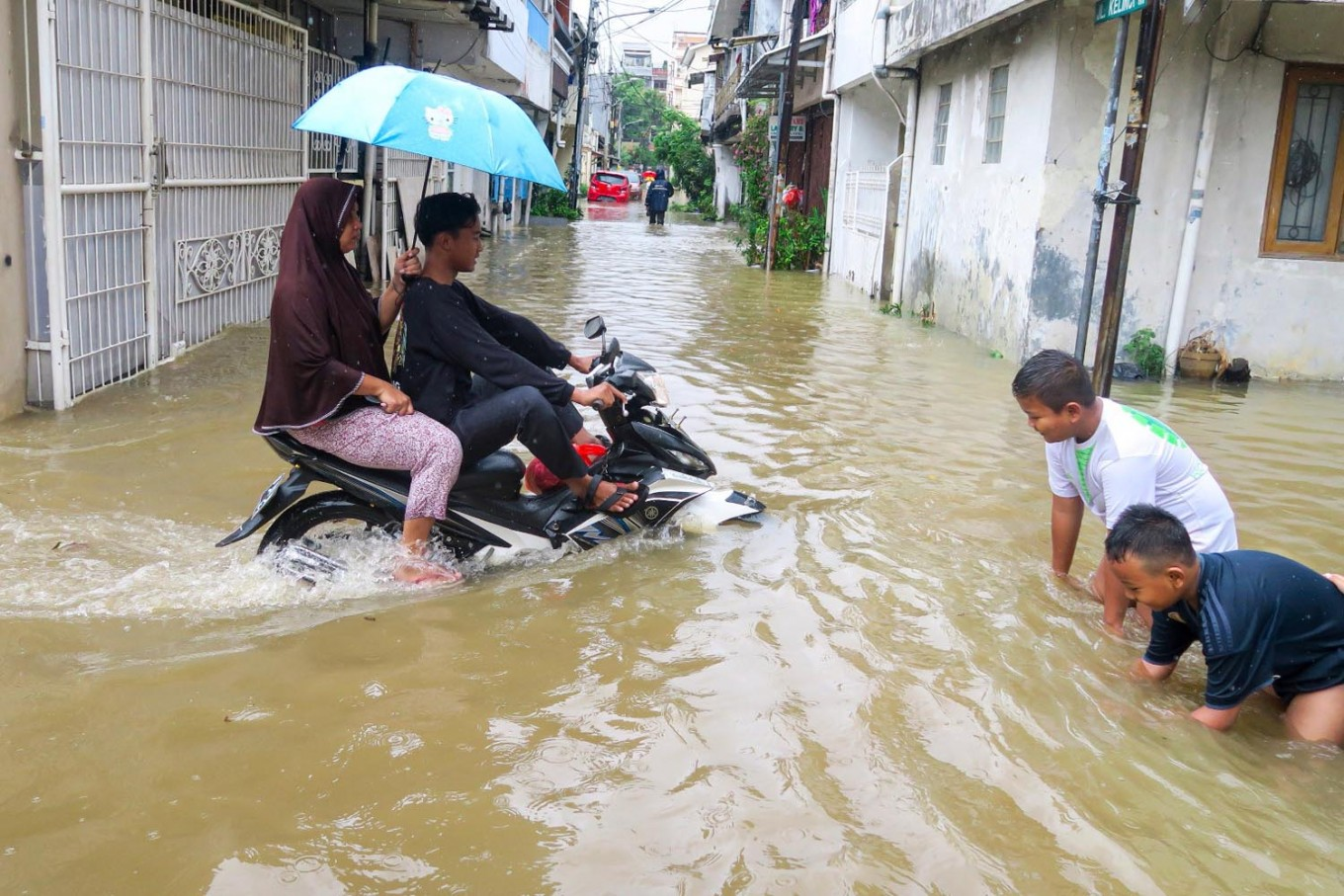 Children play during a flood in Pasar Baru, Central Jakarta, on Jan. 1. Antara/M Risyal Hidayat