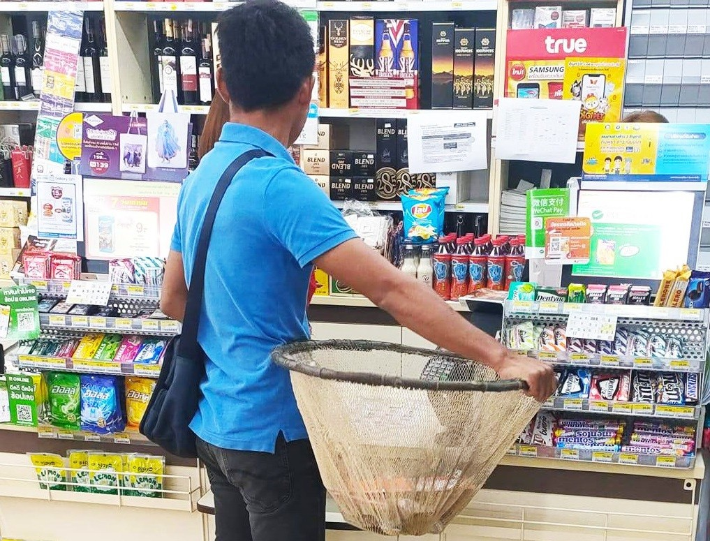 Going meme: Thai shoppers get creative after plastic bag ban