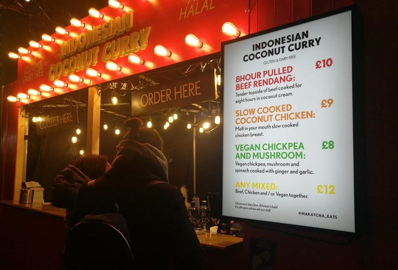 Visitors queue for 'rendang' at London Christmas market