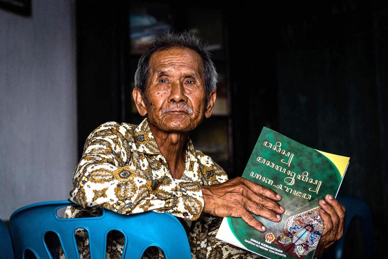 Rama Dwijo holds a Javanese textbook. JP/Anggertimur Lanang Tinarbuko