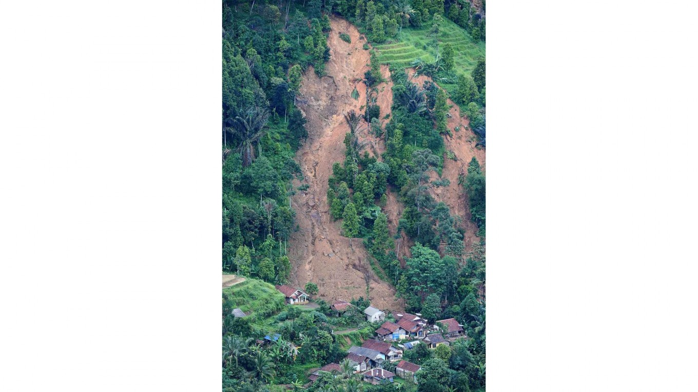 Nowhere to go: Houses are trapped under a landslide in Sukajaya, Bogor, West Java. Antara/Akbar Nugroho Gumay